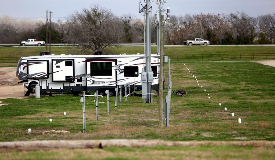 J. B. Wells RV park, along HWY 183, sits empty due to the downturn in oil jobs in the Eagle Ford shale area Wednesday, Feb. 4, 2015, in Gonzales, Texas. Five recreation vehicles were all that are remaining on the close to 400 space park. Hollas Hoffman, along with his wife Nelda Hoffman, are the founders of Oil Patch Chaplains, who provide a support system to meet the spiritual and physical needs of the oil industry. Their ministry has twenty certified chaplains and over 40 volunteers. (AP Photo/Houston Chronicle, Gary Coronado)