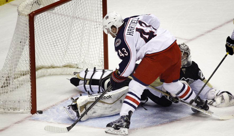 Columbus Blue Jackets' Scott Hartnell (43) scores on Pittsburgh Penguins goalie Marc-Andre Fleury (29) in the first period of an NHL hockey game, Thursday, Feb. 19, 2015, in Pittsburgh. (AP Photo/Keith Srakocic)