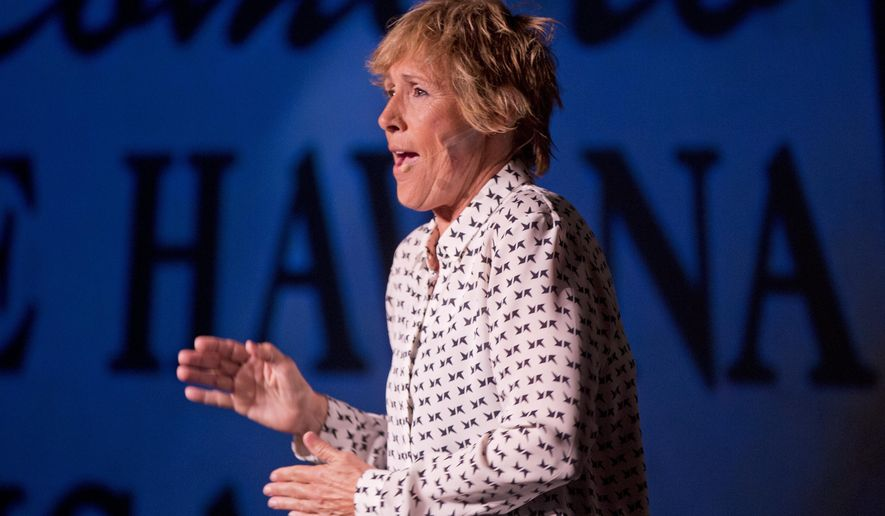 """In this Thursday, Feb. 19, 2015 photo provided by the Florida Keys News Bureau, endurance swimmer Diana Nyad performs during her one-woman play that re-creates her 111-mile swim from Cuba to Key West in a Key West, Fla., theater near the beach where she concluded the record-setting feat in September 2013. """"Onward! The Diana Nyad Story,"""" written and performed live by Nyad, opened Thursday night at The Studios of Key West and continues there through Sunday, Feb. 22. (AP Photo/Florida Keys News Bureau, Rob O'Neal)"""
