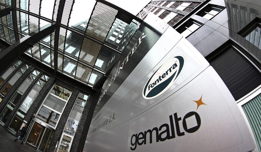"Exterior view of the building housing the head office of Gemalto, which produces ""subscriber identity modules"", or SIM cards, in Amsterdam, Netherlands, Friday, Feb. 20, 2015. Britain's electronic spying agency, in cooperation with the U.S. National Security Agency, hacked into the networks of Dutch company Gemalto to steal codes that allow both governments to seamlessly eavesdrop on mobile phones worldwide, according to the documents given to journalists by Edward Snowden. (AP Photo/Peter Dejong)"