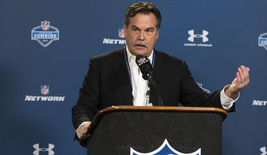 St. Louis Rams head coach Jeff Fisher talks with reporters during a news conference at the NFL football scouting combine at Lucas Oil Stadium in Indianapolis, Friday, Feb. 20, 2015. (AP Photo/Doug McSchooler)
