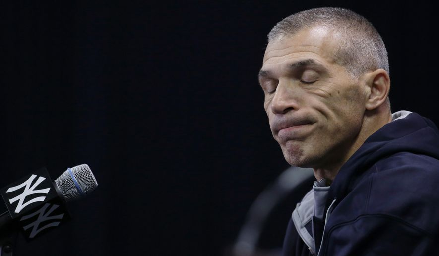 New York Yankees manager Joe Girardi closes his eyes while responding to a question during a news conference at spring training baseball , Friday, Feb. 20, 2015, in Tampa, Fla. Yankees pitchers and catchers begin official workouts Feb. 21. (AP Photo/Lynne Sladky)