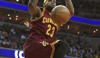 Cleveland Cavaliers forward LeBron James (23) dunks during the first half of an NBA basketball game against the Washington Wizards, Friday, Feb. 20, 2014, in Washington. (AP Photo/Nick Wass)