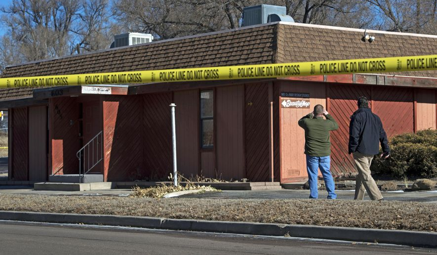 Colorado Springs, Colo., police officers investigate the scene of a Jan. 6, 2015, explosion at a building in Colorado Springs that houses a barber shop and the Colorado Springs chapter of the NAACP. (Associated Press/The Colorado Springs Gazette, Christian Murdock) **FILE**