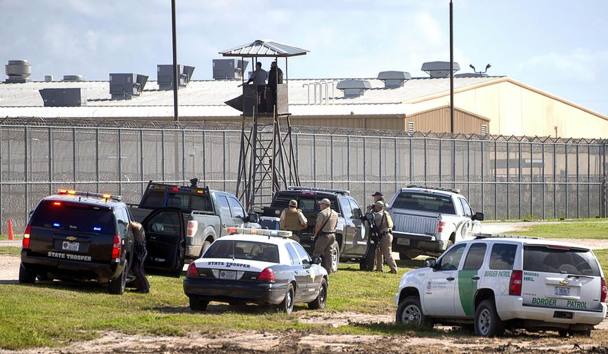 Law enforcement officials from a wide variety of agencies converge on the Willacy County Correctional Center in Raymondville, Texas on Friday, Feb. 20, 2015 in response to a prisoner uprising at the private immigration detention center. A statement from prison owner Management and Training Corp. said several inmates refused to participate in regular work duties early Friday. Inmates told center officials of their dissatisfaction with medical services. (AP Photo/Valley Morning Star, David Pike)