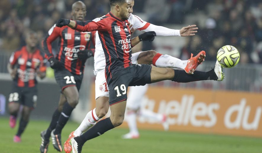 Nice's Jordan Amavi, front, challenges for the ball with Monaco's Matheus Thiago de Carvalho during their French League One soccer match, Friday, Feb. 20, 2015, in Nice stadium, southeastern France. (AP Photo/Lionel Cironneau)