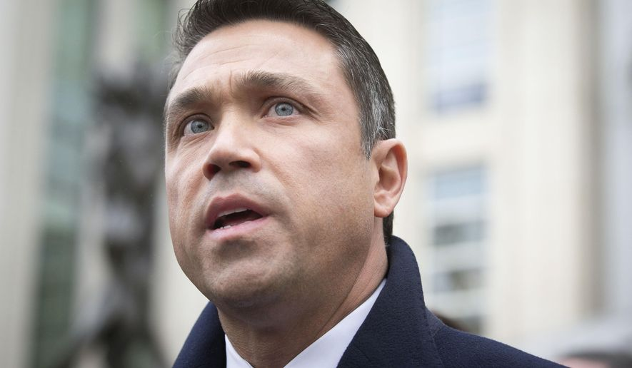 FILE - In this Dec. 23, 2014 file photo, Rep. Michael Grimm speaks to the media outside Federal court in Brooklyn after pleading guilty to a federal tax evasion charge rather than go to trial in New York.   Gov. Andrew Cuomo has scheduled a special election for May 5, 2015  to replace Grimm,.  Cuomo's announcement comes days after a federal judge ordered him to set the date by noon Friday, Feb. 20 in a lawsuit brought by voters.(AP Photo/John Minchillo)