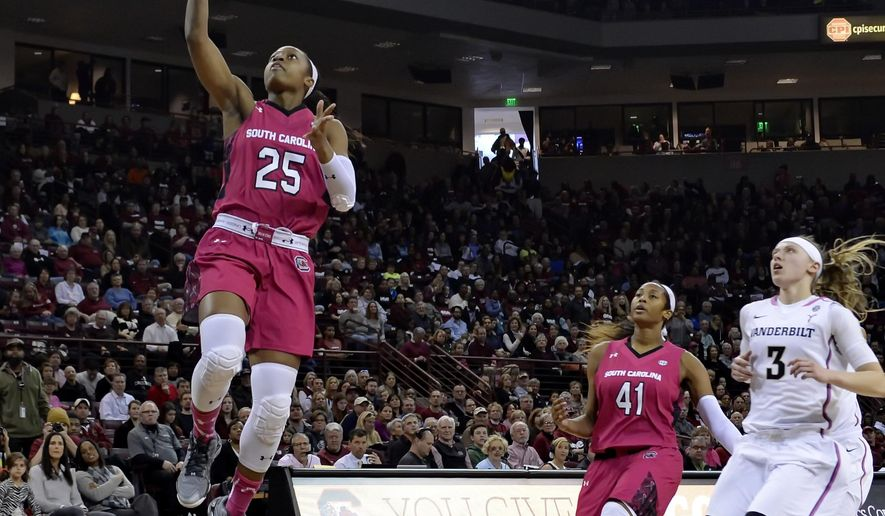 South Carolina's Tiffany Mitchell (25) drives in for a layup after making a steal during the first half of an NCAA college basketball game against Vanderbilt, Sunday, Feb. 15, 2015, in Columbia, S.C. (AP Photo/Richard Shiro)