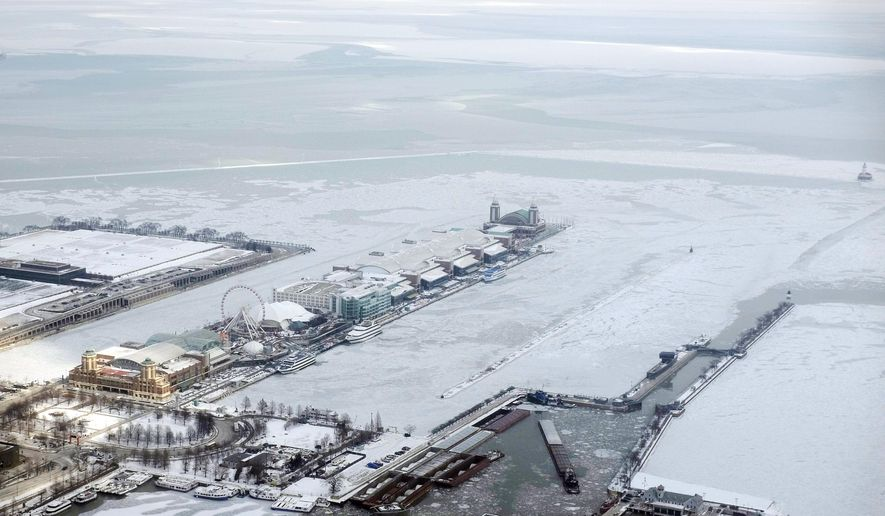 FILE - In this Feb. 17, 2015, file photo, snow coats Navy Pier surrounded by ice-covered Lake Michigan in Chicago. For the second consecutive winter, bitter weather threatens to turn the surface of the Great Lakes into a vast frozen plain. The federal Great Lakes research laboratory in Ann Arbor reports Friday, Feb. 20, that nearly 81 percent of the five lakes' surface area is ice-covered. (AP Photo/Kiichiro Sato, File)