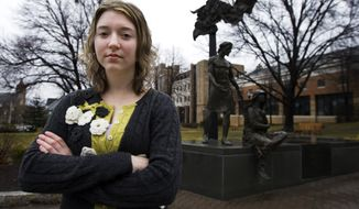 University of Scranton student Christina Drogalis, 21, from Old Forge, Pa., poses in front of a statue, depicting Jesus Christ, on campus, Wednesday, March 19, 2008, in Scranton, Pa. Drogalis, a Catholic and who opposes abortion rights, said she doesn't necessarily think voting for a candidate who is opposed to abortion really will have much effect on laws, so she's weighing a variety of issues. She, too, said she's voting for Obama. (AP Photo/Manuel Balce Ceneta)(AP Photo/Manuel Balce Ceneta) ** FILE **