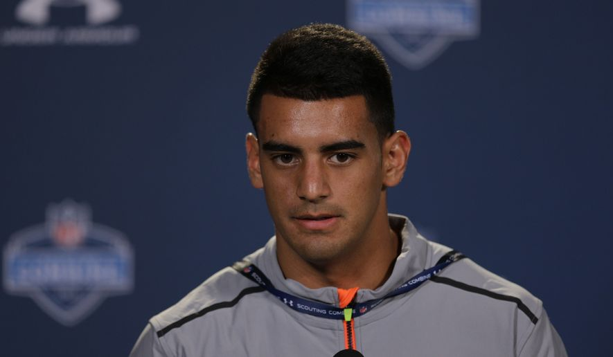 Oregon quarterback Marcus Mariota answers a question during a news conference at the NFL football scouting combine in Indianapolis, Thursday, Feb. 19, 2015. (AP Photo/David J. Phillip)