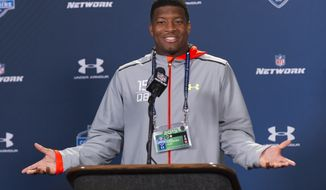 Florida State quarterback Jameis Winston talks with the media during a news conference at the NFL football scouting combine at Lucas Oil Stadium in Indianapolis, Friday, Feb. 20, 2015. (AP Photo/Doug McSchooler)