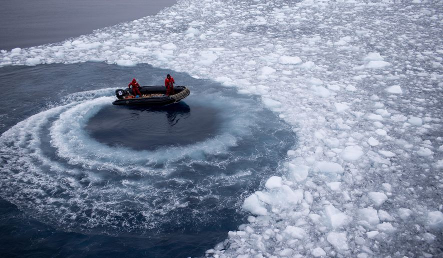 In this Jan. 22, 2015, photo, Chilean Navy officers push away ice by moving their boat in circles as they approach the Aquiles navy ship where they will pick up international scientists and take them to Chile's scientific Station Bernardo O'Higgins in Antarctica. While tourists come to Antarctica for its beauty and remoteness, scientists are all business. What they find could affect the lives of people thousands of miles away. (AP Photo/Natacha Pisarenko) ** FILE **