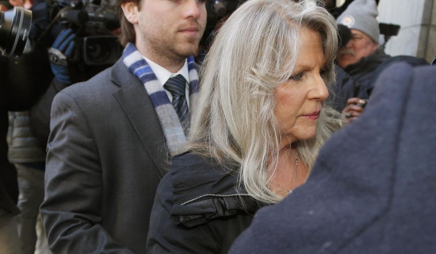 Former first lady Maureen McDonnell, right, arrives at federal court with her son Bobby for her sentencing on corruption charges in Richmond, Va., Friday, Feb. 20, 2015.  Federal prosecutors have recommended an 18-month prison term, six months less than former Gov. Bob McDonnell received when he was convicted on 11 counts last month.  (AP Photo/Steve Helber)
