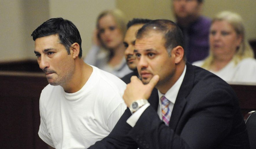 Bassel Abdul Saad (left) sits with his attorney Ali Hammoud during his arraignment before Judge Kathleen McCann in the 16th District Court in Livonia, Mich. on July 10, 2014. Saad, who is charged in the one-punch killing of referee John Bieniewicz during a game, has agreed to a plea deal with prosecutors in which he would serve 8-15 years in prison. (AP Photo/Detroit News, David Coates) **FILE**