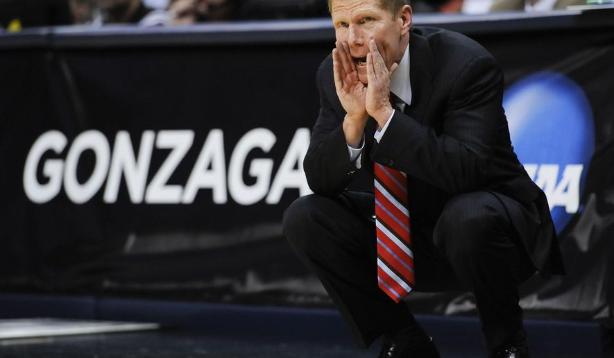 FILE - In this March 19, 2011, file photo, Gonzaga coach Mark Few calls out to players from the sidelines in the first half of a Southeast regional third round NCAA tournament college basketball game against BYU  in Denver. In the 26 years since his arrival, Few has transformed Gonzaga into a national power and brought unprecendented recognition _ not to mention resources _ to the university. (AP Photo/Jack Dempsey, File)
