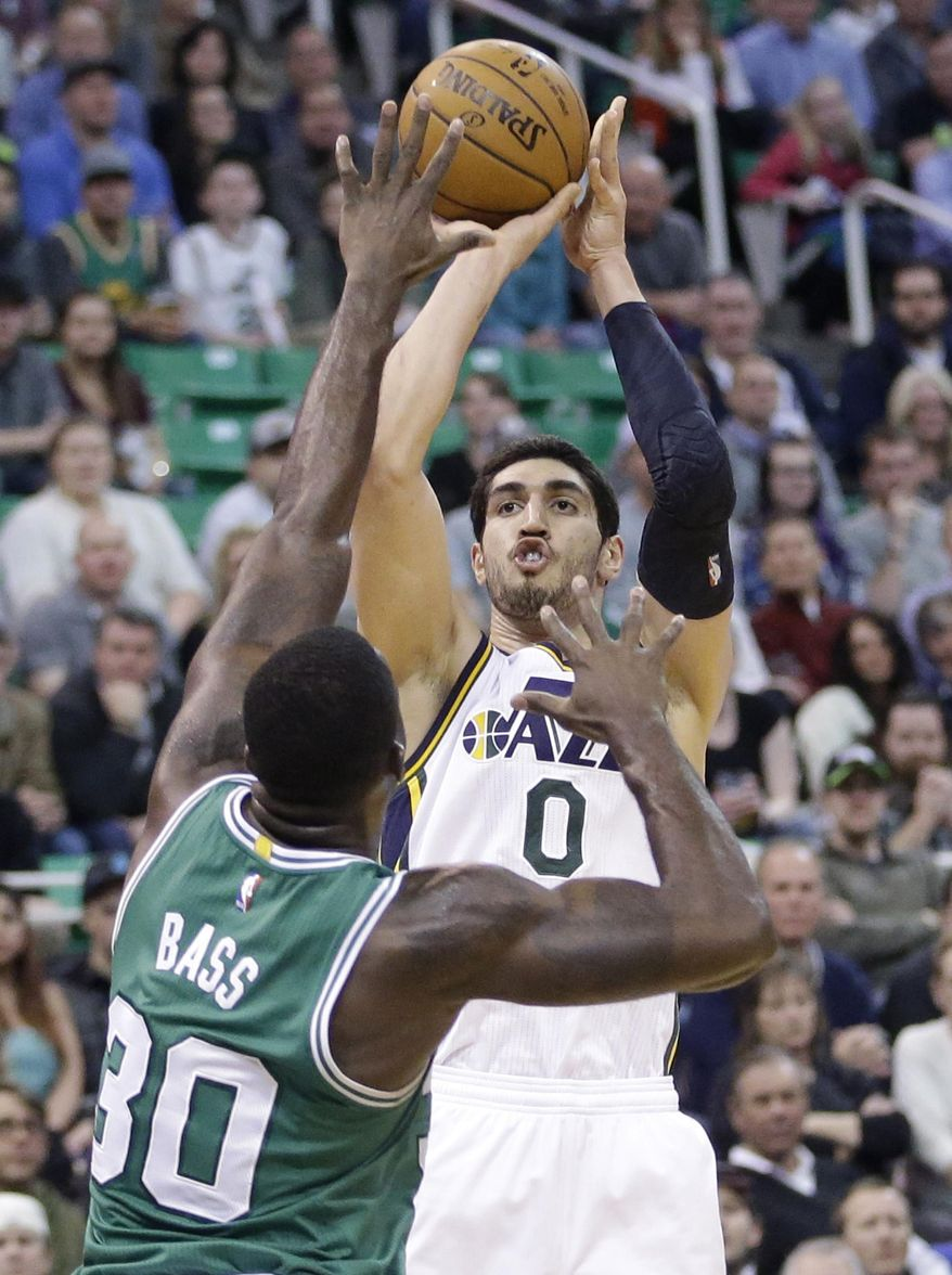 FILE - In this Jan. 26, 2015, file photo, Utah Jazz center Enes Kanter (0) shoots as Boston Celtics forward Brandon Bass (30) defends during an NBA basketball game, in Salt Lake City. A person familiar with the situation says the Jazz have traded  Kanter to the Oklahoma City Thunder for fellow center Kendrick Perkins. The person spoke Thursday, Feb. 19, 2015, on condition of anonymity because the teams had not announced the move. There likely will be more players and draft picks involved when the trade is finalized. (AP Photo/Rick Bowmer, File)