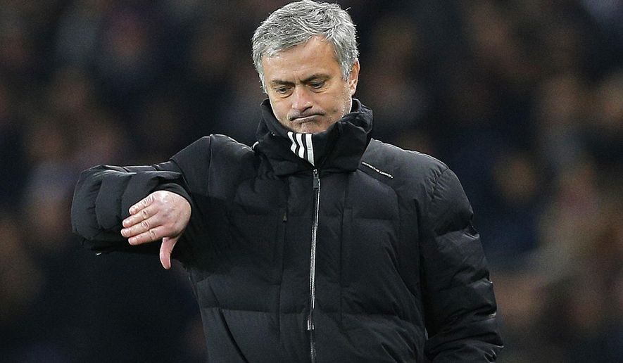 Chelsea manager Jose Mourinho gestures during the Champions League round of 16 first leg soccer match between Paris Saint Germain and Chelsea at the Parc des Princes stadium in Paris, France, Tuesday, Feb. 17, 2015. (AP Photo/Christophe Ena)