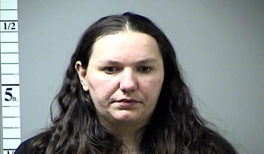 This undated photo provided by the St. Charles County Jail via St. Louis Post Dispatch, shows Sedina Hodzic. Hodzic, a Bosnian immigrant accused of funneling money and military supplies to terror groups in Iraq and Syria will remain in federal custody, after her lawyer told a judge Wednesday, Feb. 18, 2015, that he wants clarity on her immigration status before seeking bond. She is among six people named in a federal indictment earlier this month. Her husband, Ramiz Hodzic, and another man were also named, along with two people from Illinois and one from New York State. (AP Photo/St. Charles County Jail via St. Louis Post Dispatch)