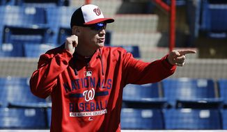Washington Nationals manager Matt Williams walks on the field in between interviews at the team's spring training baseball facility, Thursday, Feb. 19, 2015, in Viera, Fla. (AP Photo/David Goldman)
