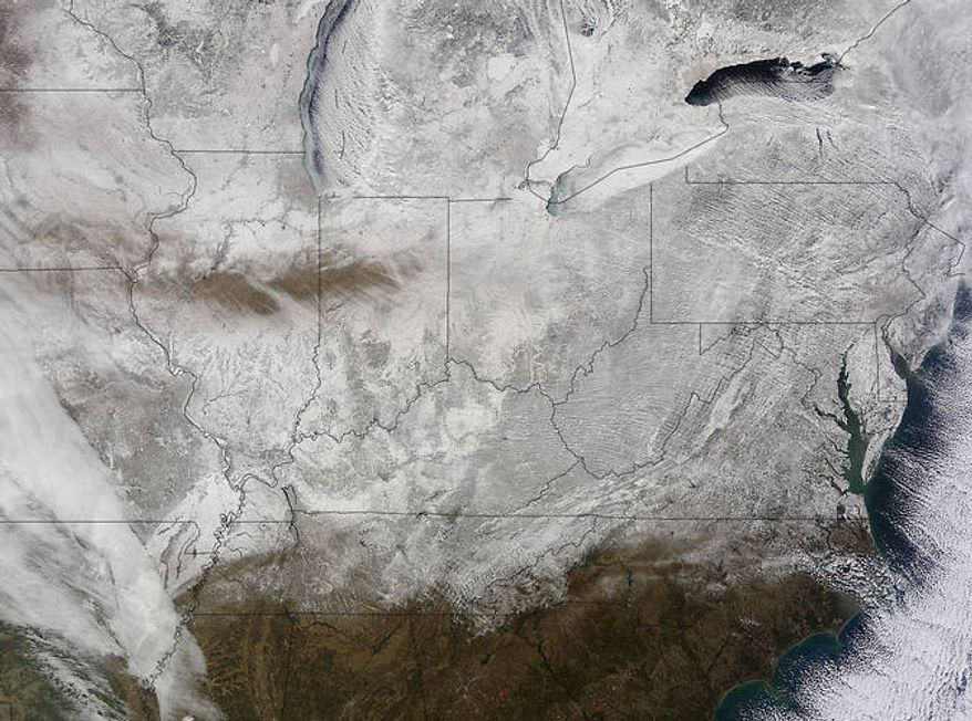"""The big snow storm from space: The NASA satellite Terra has snapped the picture of the Eastern U.S. from 200 miles up - and in the words of the space agency, it """"looks like a deep freeze."""" (NASA Goddard MODIS Rapid Response Team)"""