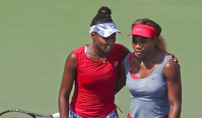 Serena Williams (right) has returned to Indian Wells, California, where in 2001 she was taunted when she won a semifinal match against sister Venus when and injury forced Venus to withdraw. (Associated Press)