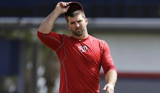 Washington Nationals' Dan Uggla walks on the field during a spring training baseball workout, Sunday, Feb. 22, 2015, in Viera, Fla. (AP Photo/David Goldman)