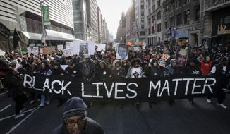 Grand juries decided not to indict officers in the chokehold death of Eric Garner in New York and the fatal shooting of Michael Brown in Ferguson, Missouri, leading to protests.  (AP Photo/John Minchillo)