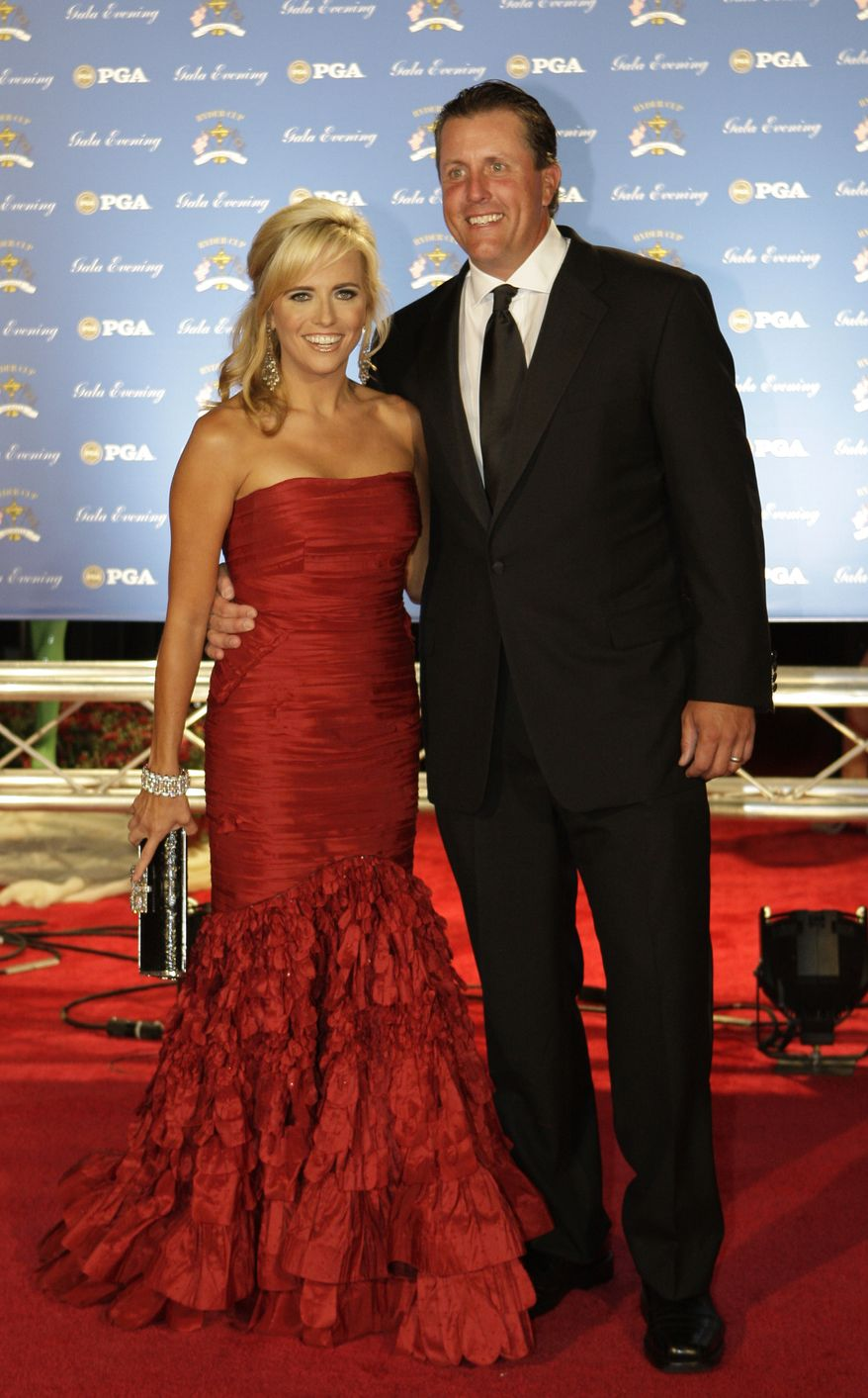 United States Ryder Cup golfer Phil Mickelson and his wife Amy arrive at the 37th Ryder Cup Gala in Louisville, Ky., Wednesday, Sept. 17, 2008. (AP Photo/Rob Carr)']
