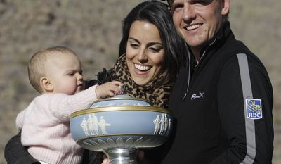 [u'the finals of the Match Play Championship golf tournament Sunday, Feb. 27, 2011, in Marana, Ariz. (AP Photo/Elaine Thompson)', u'Luke Donald, right, of England poses with the Walter Hagen trophy along with his wife Diane Donald, center, and 1-year-old daughter Elle after defeating Martin Kaymer of Germany 3 and 2 in the finals of the Match Play Championship golf tournament Sunday, Feb. 27, 2011, in Marana, Ariz. (AP Photo/Elaine Thompson)']