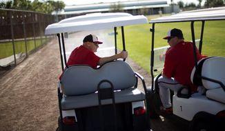 Washington Nationals manager Matt Williams, left, talks with pitching coach Steve McCatty during a spring training baseball workout, Sunday, Feb. 22, 2015, in Viera, Fla. (AP Photo/David Goldman)
