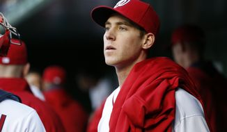 Washington Nationals starting pitcher Taylor Jordan (38) pauses in the dugout before a baseball game against the St. Louis Cardinals at Nationals Park Thursday, April 17, 2014, in Washington. (AP Photo/Alex Brandon)