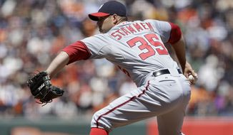 Washington Nationals pitcher Craig Stammen (35) throws against the San Francisco Giants in a baseball game in San Francisco, Thursday, June 12, 2014. (AP Photo/Jeff Chiu)
