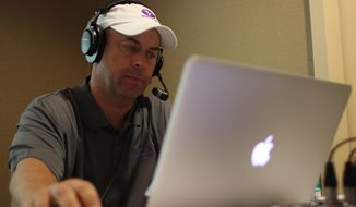Steve Czaban, a McLean, Virginia native, checks his computer while hosting a sports radio show on Yahoo! Sports Radio. Czaban has been on air 25 years, with stints locally and in places such as Santa Barbara, California and in Charlotte. (Courtesy of Steve Czaban)
