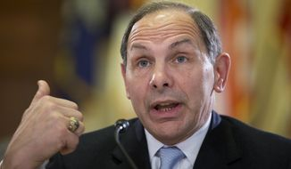 Veterans Affairs Secretary Robert McDonald embellished his record to a homeless veteran in Los Angeles who said he had been a member of the special forces before his current hard times. (Associated Press)