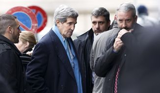 U.S. Secretary of State John Kerry, center, arrives at the hotel prior to a bilateral meeting with Iranian Foreign Minister Mohammad Javad Zarif  for a new round of Nuclear Talks, in Geneva, Switzerland, Sunday, Feb.  22, 2015. (AP Photo/Keystone,Salvatore Di Nolfi)