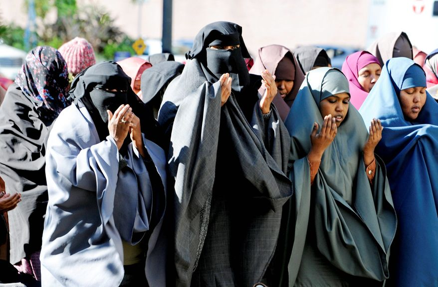 "Women in traditional Muslim dress take part in prayers outside the federal courthouse before a jury found 35-year-old Amina Farah Ali and 64-year-old Hawo Mohamed Hassan guilty on all counts Thursday, Oct. 20, 2011, in Minneapolis of conspiring to funnel money to a terrorist group in Somalia. Prosecutors say the women, U.S. citizens of Somali descent, were part of a ""deadly pipeline"" that routed money and fighters from the U.S. to Somalia. (Associated Press)"