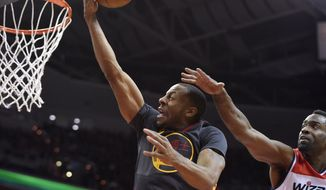 Golden State Warriors guard Andre Iguodala, left, goes to the basket against Washington Wizards forward Martell Webster, right, during the first half of an NBA basketball game, Tuesday, Feb. 24, 2015, in Washington. (AP Photo/Nick Wass)