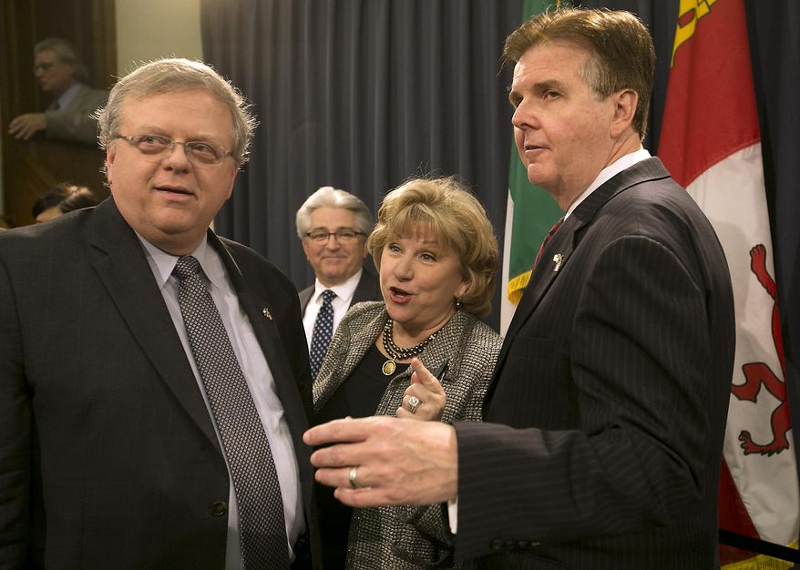 Texas Senator Jane Nelson, R-Flower Mound, center, who has filed SB2 the senate's version of the appropriations bill, is joined by Lt. Governor Dan Patrick, right, and Senator Paul Bettencourt at a press conference at the Capitol in Austin, Texas, as she filed three pieces of legislation to provide tax relief for Texas families and businesses. (AP Photo/Austin American-Statesman, Ralph Barrera)