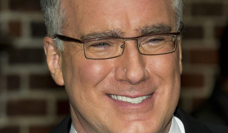 """FILE - In this Oct. 24, 2011 file photo, Keith Olbermann leaves a taping of the """"Late Show with David Letterman,"""" in New York. Olbermann was taken off his ESPN show for the rest of the week after making insulting comments about Penn State students on Twitter Monday, Feb. 23, 2015. (AP Photo/Charles Sykes, file)"""