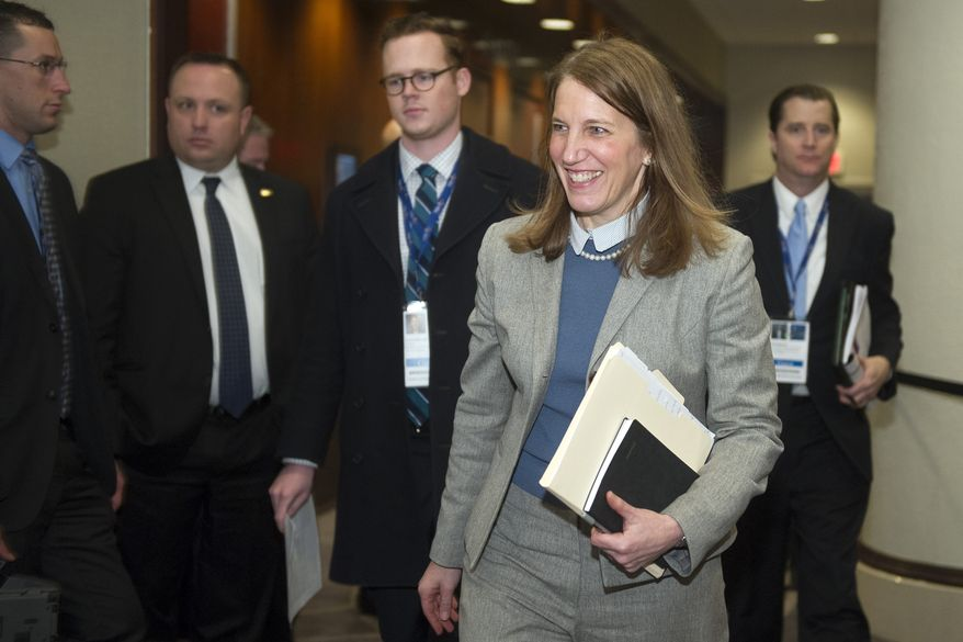 Health and Human Services Secretary Sylvia Mathews Burwell departs a governors only luncheon after giving an address during the  National Governors Association Winter Meeting in Washington on Feb. 22, 2015. (Associated Press) **FILE**