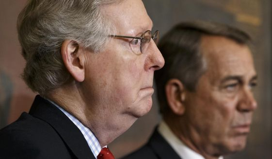 Senate Majority Leader Mitch McConnell, R-Ky., left, and Speaker of the House John Boehner, R-Ohio, stand together Feb, 13, 2015, at a ceremony before the signing of the bill authorizing expansion of the Keystone XL pipeline, at the Capitol in Washington. (Associated Press) **FILE**