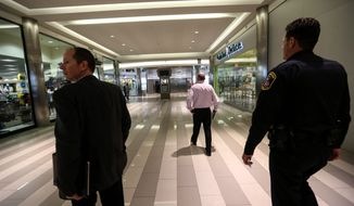 Security officials are maintaining their presence at the Mall of America in Bloomington, Minnesota. Al-Shabab released a video threat through Twitter on Friday saying it would conduct shooting attacks at seven shopping centers around the world. (Associated Press)
