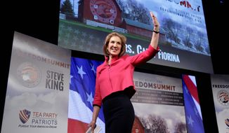 Carly Fiorina waves after speaking at the Freedom Summit, Saturday, Jan. 24, 2015, in Des Moines, Iowa. (AP Photo/Charlie Neibergall) ** FILE **
