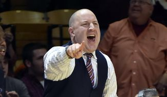 Virginia Tech's Head Coach Buzz Williams instructs his players during the first half of an NCAA college basketball game Wednesday Feb. 25, 2015, in Blacksburg, Va. (AP Photo/Don Petersen)