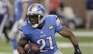 FILE - In this Oct. 29, 2014, file photo, Detroit Lions running back Reggie Bush carries the ball against the New Orleans Saints during an NFL football game in Detroit. The Lions released Bush on Wednesday, Feb. 25, 2015, halfway through the four-year deal he signed as a free agent before the 2013 season. (AP Photo/Duane Burleson, File)