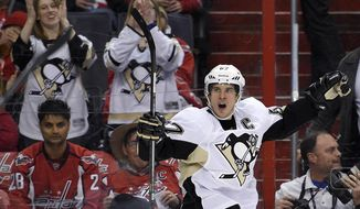 Pittsburgh Penguins center Sidney Crosby (87) celebrates his goal against the Washington Capitals during the second period of an NHL hockey game, Wednesday, Feb. 25, 2015, in Washington. (AP Photo/Nick Wass)