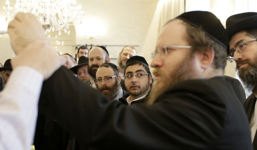 Rabbis take part in a first aid training during the Conference of European Rabbis in Prague, Czech Republic, Tuesday, Feb. 24, 2015. Due to the recent attacks on Jewish communities in Europe, part of the conference was a self defense and first aid training. (AP Photo/Petr David Josek)