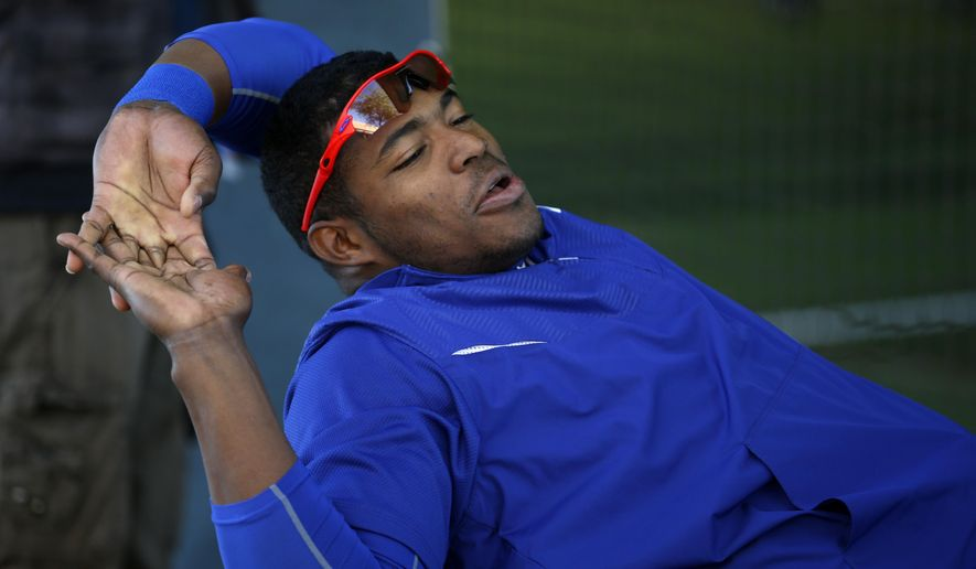 Los Angeles Dodgers' Yasiel Puig relaxes before a spring training baseball workout Wednesday, Feb. 25, 2015, in Phoenix. (AP Photo/John Locher)