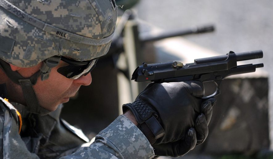 1st Lt. Lyndon Hill, assigned to 30th Medical Command, fires the M9 pistol during United States Army Europe's Best Junior Officer Competition (BJOC) in Grafenwoehr, Germany, July 24, 2012. The BJOC, unique to the U.S. Army in Europe, is a training event for company-grade officers ranking from 2nd Lt. to Capt. meant to challenge and refine competitors' leadership and cognitive decision-making skills in a high-intensity environment. (U.S. Army photo by Visual Information Specialist Gertrud Zach/Released)